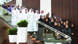 The interns with at the Qatar Airways office.