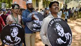 Indian students and activists holding 'I am Gauri' placards take part in a rally held in memory of j