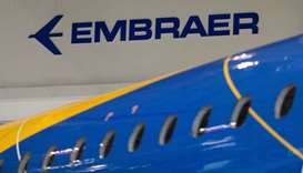 The logo of Brazilian planemaker Embraer SA is seen at the company's headquarters in Sao Jose dos Ca