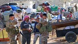 Syrians prepare to leave their refugee camp in the city of Arsal in Lebanon's Bekaa valley on the ea