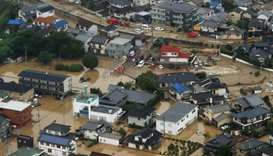 An aerial view of flooded houses in Saka Town, Hiroshima prefecture