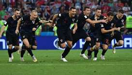 Croatia's players celebrate their winning penalty