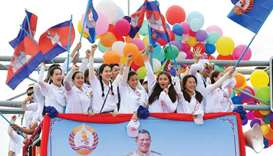 Supporters of Cambodian People's Party (CPP) parade in an open truck during the first day of campaig