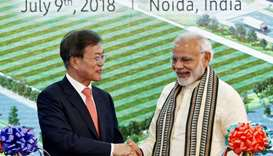 South Korean President Moon Jae-in and Indian Prime Minister Narendra Modi shake hands after inaugur