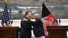 US Secretary of State Mike Pompeo (L) shakes hands with Afghan President Ashraf Ghani (R) after a pr