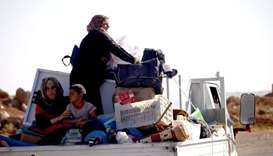 A Syrian family returns to their homes in towns and villages situated on the eastern outskirts of Da