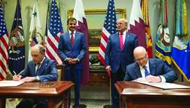 HE al-Baker and Joyce sign the agreement between Qatar Airways Group and GE at the White House in Wa