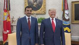 His Highness the Amir and President Trump pose for a photograph