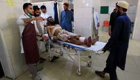 An injured man receives a treatment at the hospital, after a suicide attack in Jalalabad, Afghanista