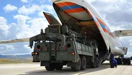 First parts of a Russian S-400 missile defence system are unloaded from a Russian plane at Murted Ai