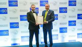 QIB Group CEO Bassel Gamal (right) receiving the award during the 2019 Euromoney's Awards