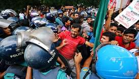 People clash with police near the Ministry of Power Energy and Mineral Resources as they protest aga