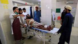 An injured man receives a treatment at the hospital, after a July 12 suicide attack in Jalalabad