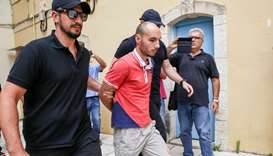 Plain-clothes police officers escort the suspect (C) for the murder of American biologist Suzanne Ea