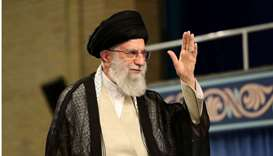 Iran's Supreme Leader Ayatollah Ali Khamenei waves during ceremony attended by Iranian clerics in Te