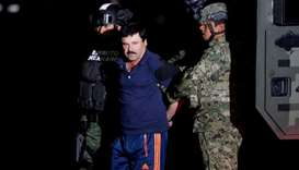 "Joaquin ""El Chapo"" Guzman is escorted by soldiers during a presentation in Mexico City, January 8, 2"