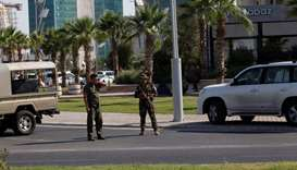 :Kurdish security members stand guard near a restaurant where Turkish diplomats and Turkish consulat