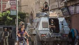 Egyptian policemen stand guarding a street in the North Sinai provincial capital of el-Arish. File p