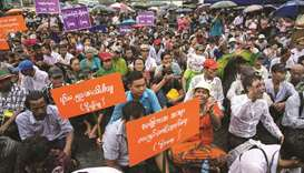 People participate in a demonstration to protest proposed amendments to the 2008 Myanmar Constitutio