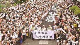 A group of elderly people march to the government headquarters in Hong Kong yesterday, in the latest