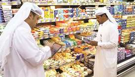 Municipal officials inspecting food items at an outlet.