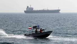 In this file photo taken on July 02, 2012 Iranian Revolutionary Guards drive speedboats in front of