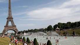 People bathe in the Trocadero Fountain near the Eiffel Tower in Paris during a heatwave on June 28.