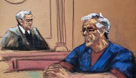US financier Jeffrey Epstein looks on near Judge Richard Berman during a bail hearing in his sex tra