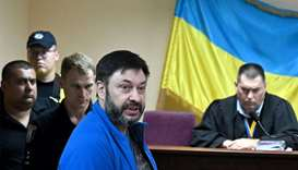 Ukrainian-Russian journalist Kyrylo Vyshynsky (C) speaks during a court hearing in Kiev on July