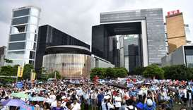 People attend a pro-government rally outside the government headquarters in Hong Kong