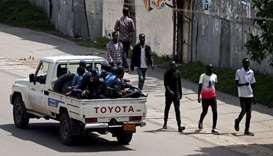 Armed security officers patrol the street during a clash between a Sidama youth and security officer