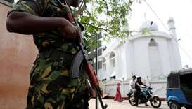 A soldier stands guard outside the Grand Mosque, days after a string of suicide bomb attacks on chur