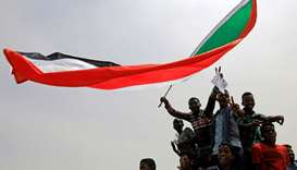 Sudanese shout slogans during a demonstration demanding the ruling military hand over to civilians i