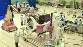 Indian Space Research Organisation (ISRO) scientists work on the orbiter vehicle of 'Chandrayaan-2'