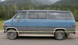 A blue 1986 Chevrolet van at the scene of a double homicide in northern British Columbia
