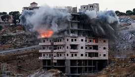 This picture shows the demolition of a Palestinian building which was under construction, in the Pal