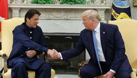 Pakistan's Prime Minister Imran Khan shakes hands with US President Donald Trump at the start of the