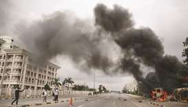 People walk in a street of Abuja during clashes between members of the Islamic Movement of Nigeria (