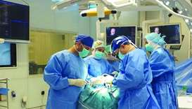 Surgeons at Hamad General Hospital performing the surgery.