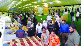 Residents visiting the Local Dates Festival at Souq Waqif.