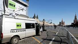 Vehicles of Russian state-controlled broadcaster Russia Today (RT) are seen at Red Square in central