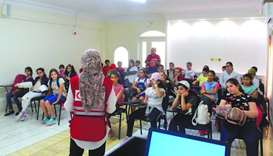 A group of students attending a health education session organised by QRCS.