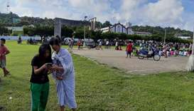 People gather on a field after an earthquake struck the Batanes Province, in northern Philippines