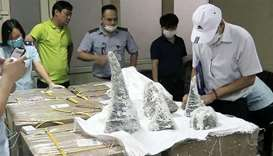 Customs officials at Noi Bai International Airport removing smuggled rhino horn pieces from packagin