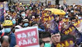 Protesters take part in a demonstration against what activists say is police violence in Hong Kong