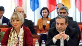 Abbas Araqchi and Helga Schmid attend a meeting of the JCPOA Joint Commission in Vienna