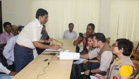 Rohingya community leaders (L) talk with members of a team from the Association of Southeast Asian N