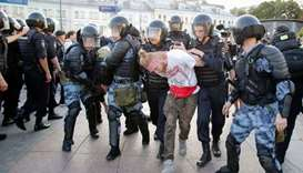 Riot police officers detain protesters during an unauthorised rally demanding independent and opposi