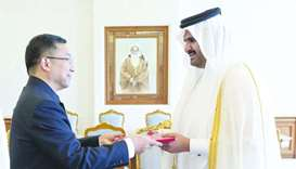 His Highness the Deputy Amir Sheikh Abdullah bin Hamad al-Thani receives the credentials of  Zhou Ji