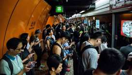 Commuters line up on a Mass Transit Railway (MTR) platform in Hong Kong